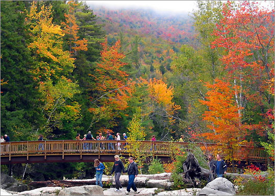Leaf-peepers enjoy the foliage at Rocky Gorge, a stop along the Kancamagus Highway.