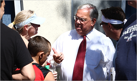 Menino spoke with race and parade goers.