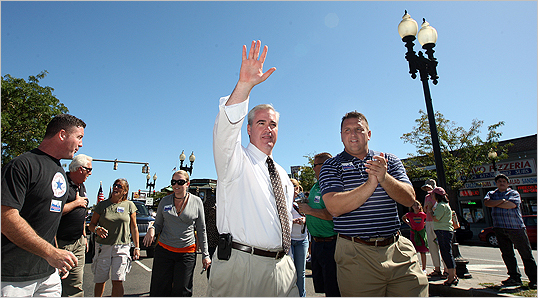 Flaherty waved while walking in the parade.