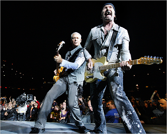 Adam Clayton played bass as the Edge sang backup vocals and picked his guitar.