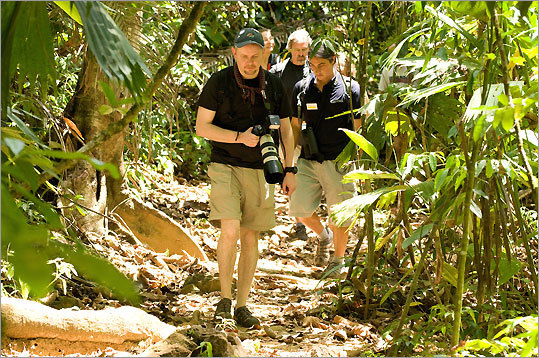 Stewart Rhodes from England, Kerrick James, guest photographer from Mesa, Ariz., and Alex Lopez, a Costa Rican Cruise West guide and exploration leader in Corcovado Conservation Area, a private park in southeastern Costa Rica.
