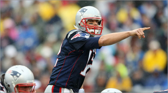 Patriots quarterback Tom Brady called out a play during the first half.