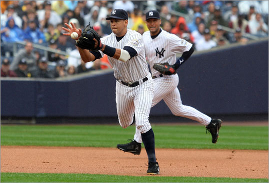 (continued) On Lowell's single, Yankees third baseman Alex Rodriguez bobbled the ball after it deflected off Andy Pettitte.