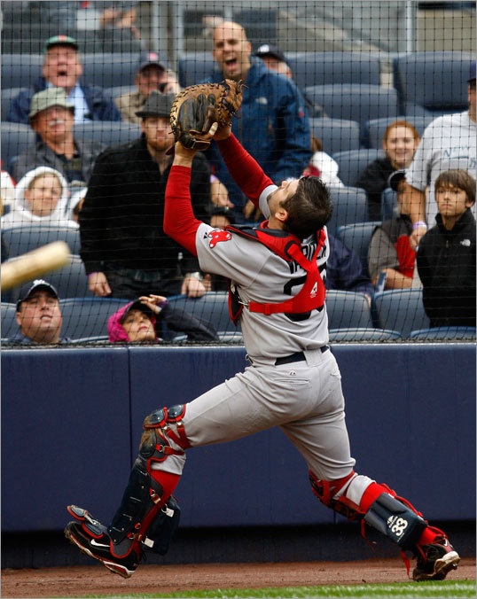 Jason Varitek went behind home plate to catch a foul ball by Hideki Matsui (not pictured) in the second inning.