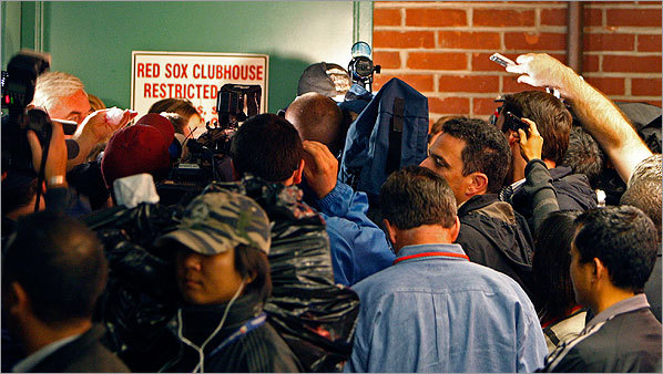Entering Wednesday's action with a magic number of 1, the Red Sox failed to clinch a postseason berth on the field by falling to Toronto. But when Texas lost to the Angels on the west coast, Boston clinched the American League wild card and players celebrated inside the team's clubhouse (which the media was not allowed to enter). Check out our photos from the game and late-night celebration.