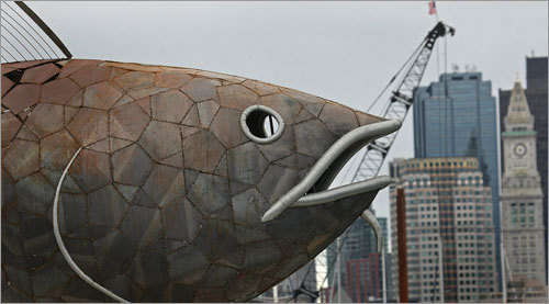 The sculpture, dubbed the Fish, was ferried by barge from the Boston Harbor Shipyard in East Boston to Fan Pier Marina on the South Boston waterfront.