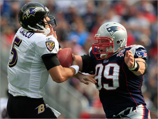 Mike Wright was called for a personal foul as he takes a swipe at Baltimore Ravens quarterback Joe Flacco's head in the second quarter.