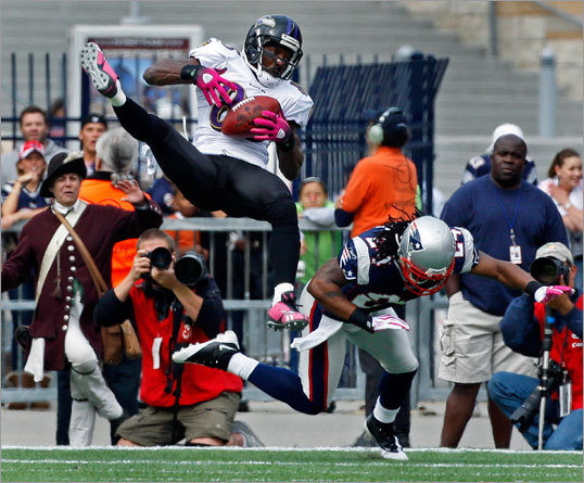 Derrick Mason of the Ravens made a touchdown catch as Jonathan Wilhite took his legs out from underneath him.