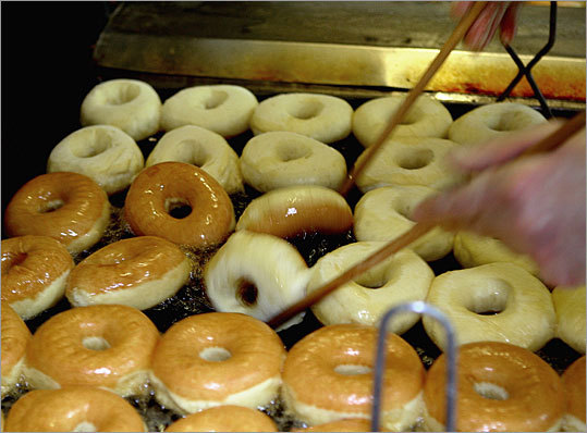 Glod turns the doughnuts using wooden drum sticks that barely touch the rings. Unique offerings, like blueberry cake munchkins and glazed jelly doughnuts, have helped the sisters cultivate a fiercely loyal following, and have attracted customers who would rather drive here than buy the doughnuts at the Dunkin's in their own towns.