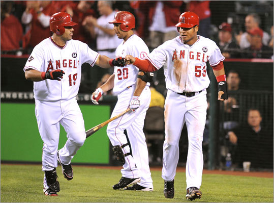 Bobby Abreu (left) scored the Angels' first run on a sacrifice fly by Kendry Morales in the fourth inning.