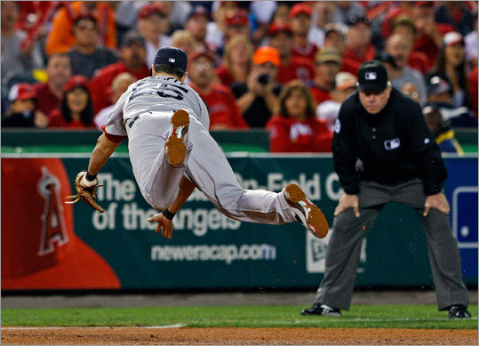 Third baseman Mike Lowell made a diving catch to rob Torii Hunter of a hit in the fourth inning.