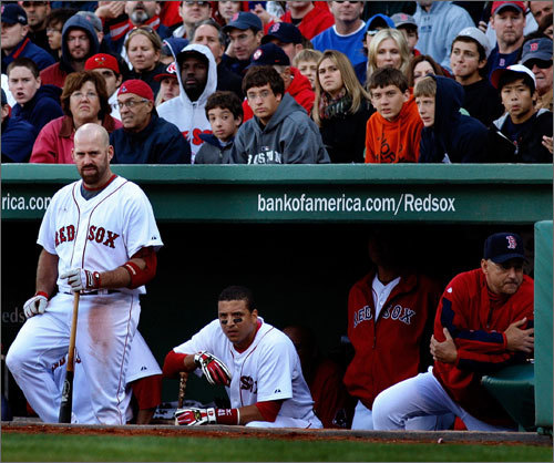 The Red Sox dugout watches on as Dustin Pedroia takes the final at-bat of the 2009 season.