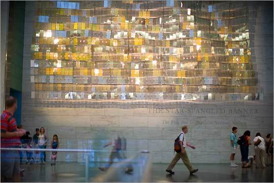 "Some of the 960 pieces of mirrored polycarbonate in ""Abstract Flag,'' a 40-by-19-foot reflecting installation at the National Museum of American History."