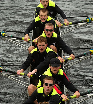 The Men's Club Eights team from Northeastern University approach the one-mile marker on the Charles River near the Western Ave. bridge. See the results of this race.