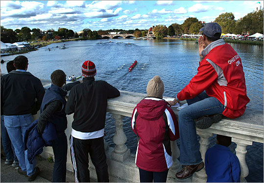 Spectators watch the Men's Alumni Eights race from the Weeks footbridge. See the results of this race .