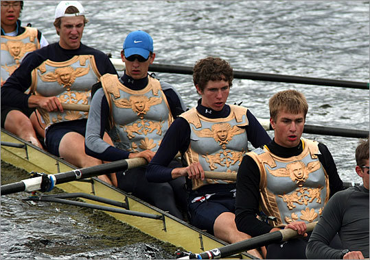 Members of this one Men's Club Eights team from Harvard wear decorative body armor as they row to the starting line.