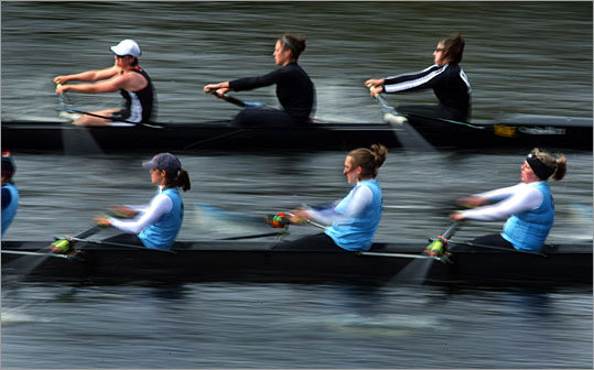 The Women's Club Eights teams from Lafayette College (foreground) and Portland Women's Rowing Club are a blur as they approach the River Street Bridge on the Charles River. See the results of this race .