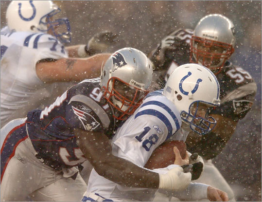 Jan. 18, 2004: Patriots 24, Colts 14 In the AFC Championship Game, Colts quarterback Peyton Manning was sacked three times by Jarvis Green (left), and Manning was intercepted three times by Ty Law and four times total. Tom Brady hit 22 of 37 passes for 237 yards and Antowain Smith gained 100 yards on 22 carries. The Patriots built a 15-0 lead by halftime.