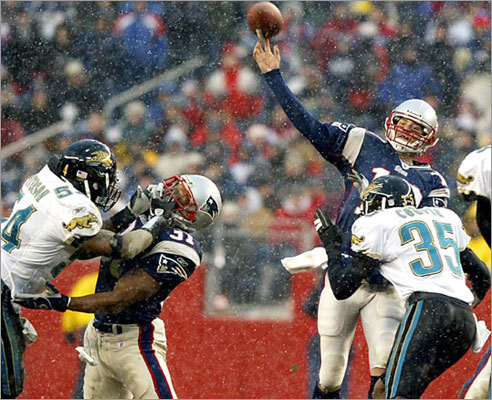 Dec. 14, 2003: Patriots 27, Jaguars 13 On a frigid day with temperatures around 25 with a wind chill that reduced it to 16, Patriots quarterback Tom Brady tried to pass to fullback Larry Centers (31, center), who had Jacksonville linebacker Mike Peterson in his face. The victory made the Patriots 12-2 for the first time in franchise history. Brady passed for 228 yards and a pair of touchdowns, Tyrone Poole had two interceptions and the Patriots won their 10th straight.