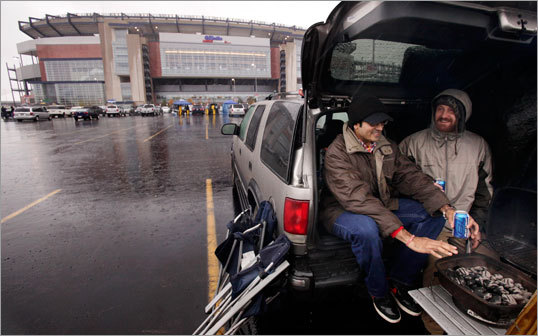 It was a rough day for tailgating for Soham Bhatt (left) and Chris Camillucci (right), both of Upton.