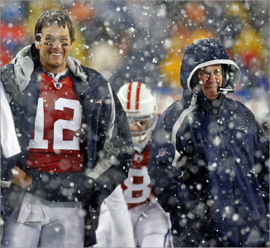 Starting quarterback Tom Brady (left) and coach Bill Belichick got a good laugh watching the replay on the scoreboard of the celebration technique of backup quarterback Brian Hoyer (8, in the background between them) following his third-quarter touchdown.