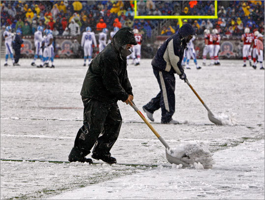 Gillette Stadium workers cleared snow from the field to improve the visibility of the lines during a break in the action in the first half.