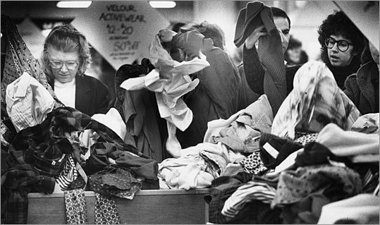 Shoppers search through Filene's Basement's trademark bins on Jan. 1, 1988. A main draw to the downtown location was the 'automatic markdown' feature. The Basement pioneered the concept of bargains when it devised a system where merchandise is discounted on a set schedule that customers could track.