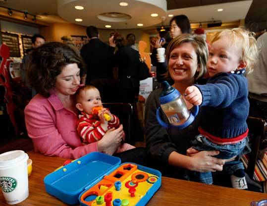 Liz Brown, 39, of Dedham (near left, with daughter, Rachel Adler, 13 months, at a Needham Starbucks) left her first career as an attorney, but would like to return to work in something that combines her passions for causes such as children's issues with previously underused people and creative skills. Phoebe Peabody, 37, of Needham (right, with son, Asher Shillin, 13 months) worked at a private wealth management company. She's hoping to combine interests in cutting-edge technological and social trends with her traditional business background.
