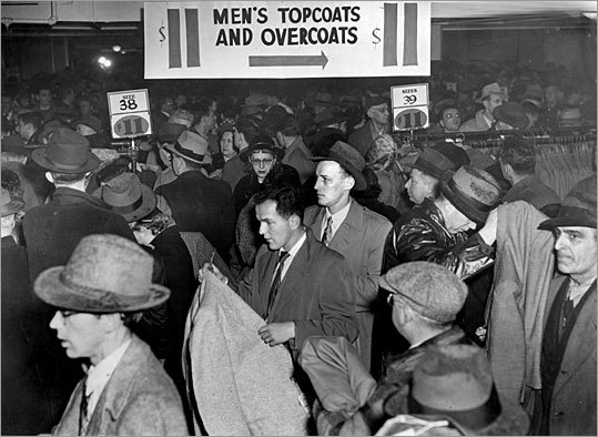 Male shoppers crowded the racks for coats in this photo from 1953. The store's subterranean location and discount prices helped coin the term 'bargain basement.'