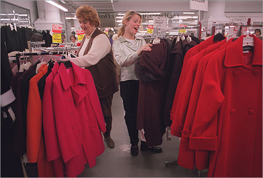 Mary Smith and Tina Lawrence, workers at the just-opened Vault section of Filene's Basement's Downtown Crossing location, went over merchandise before the lunchtime shopping crowd arrived to look for bargains in this photo.