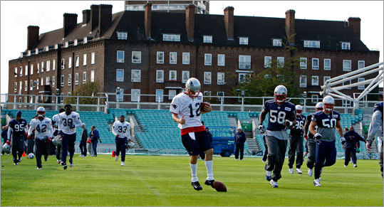 After arriving in London, the Patriots held a workout out at the Brit Oval, a cricket facility, on Friday. Tom Brady (12) demonstrated his soccer moves at the start of the workout.