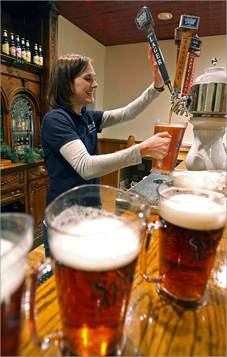 Barbara Silk pours pitchers of Sam Adams Boston Lager in preparation for a tasting by a tour group in early 2009.