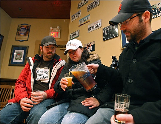 Chris Luedtke (right) of Milford, N.H., pours Sam Adams Boston Lager for Nina Raposa and Tom Halloran at the conclusion of their tour.