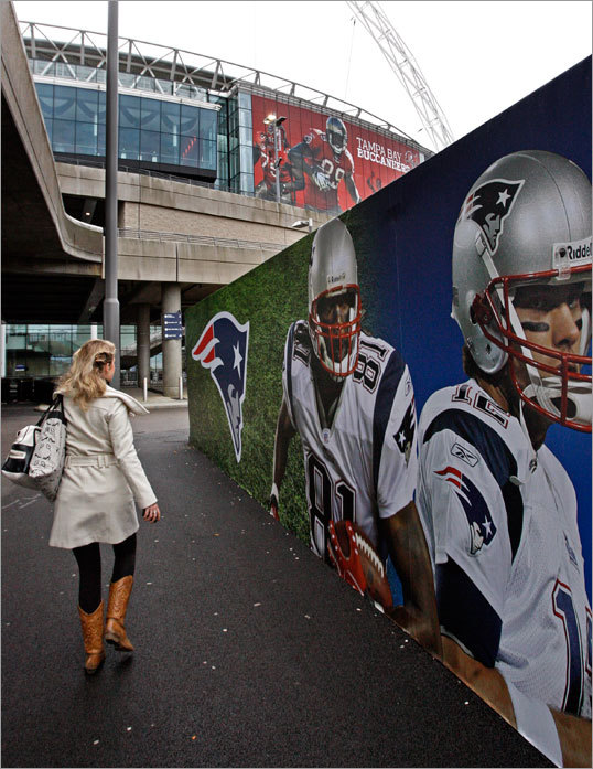 A billboard outside Wembley Stadium sported images of Randy Moss and Tom Brady.