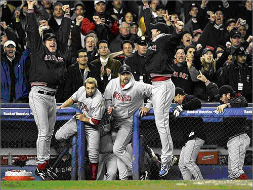 In 2004, the Red Sox capped off a comeback of legendary proportions, rallying from a 3-0 deficit in the American League Championship Series to to beat the Yankees in seven games, then going on to beat St. Louis for their first World Series in 86 years. In a year in which Sox fans will have to watch the Yankees compete for a World Series, it seems appropriate, on the five-year anniversary, to look back on the incredible journey of the 2004 Red Sox team. Here, Curt Schilling (left) and Derek Lowe (right) jump into the air as their teammates pour out of the dugout following the final out of Game 7 of the ALCS, in which the Red Sox beat the Yankees, 10-3.
