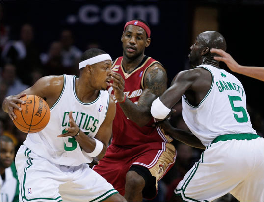Paul Pierce dribbled into a screen set for him by Kevin Garnett (right), allowing Pierce to squeeze past Cleveland's LeBron James.