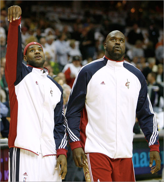 LeBron James (left) and Shaquille O'Neal warmed up before the game.