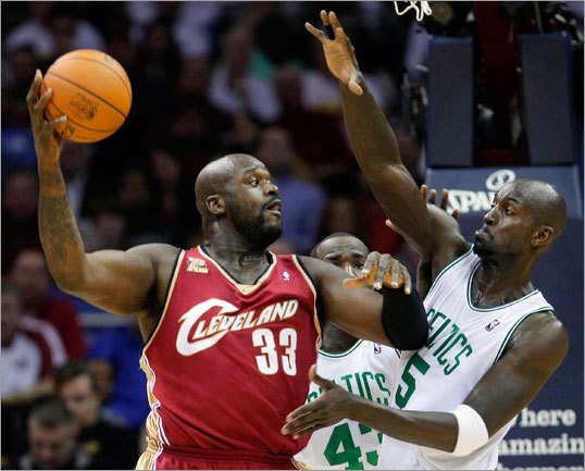 Cleveland's Shaquille O'Neal (left) was defended by Kevin Garnett.