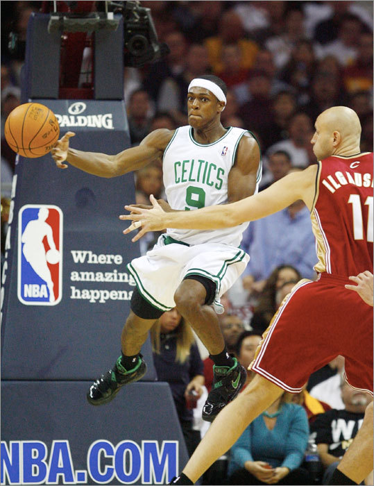 Rajon Rondo, here passing around Zydrunas Ilgauskas, had eight points in the season opener.