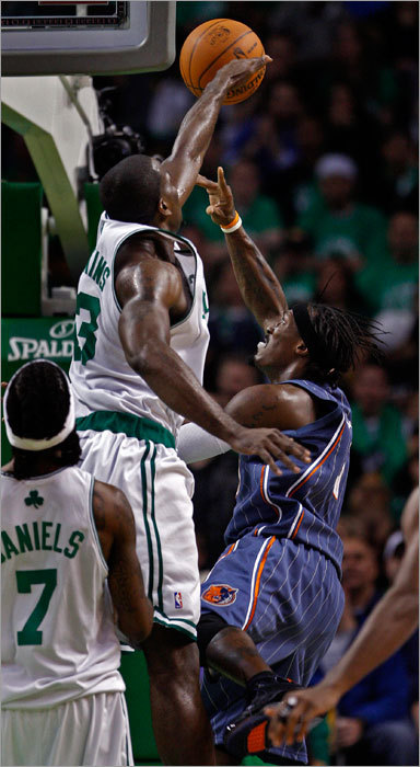 Celtics center Kendrick Perkins blocked a second-quarter shot by Gerald Wallace.