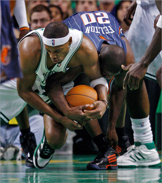 Celtics forward Paul Pierce and Raymond Felton battled for a loose ball, and Pierce came away in pain after the scrum.