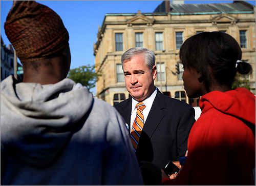 Mayoral candidate Michael Flaherty, center, talks with Natasha Dallas, left, and Minnie Tyson. He was in Roxbury meeting voters.