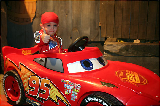 Alexavier raced around Salem in his McQueen car.