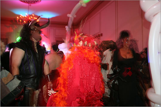 Costumed ball goers on the dance floor.