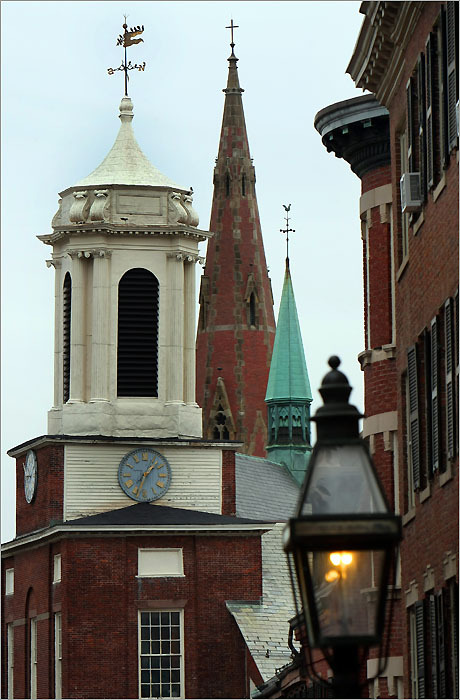 The Charles Street Meeting House(left) and the spires of the Church of the Advent rise above the Beacon Hill Skyline. The Advent's spire is 172 feet high