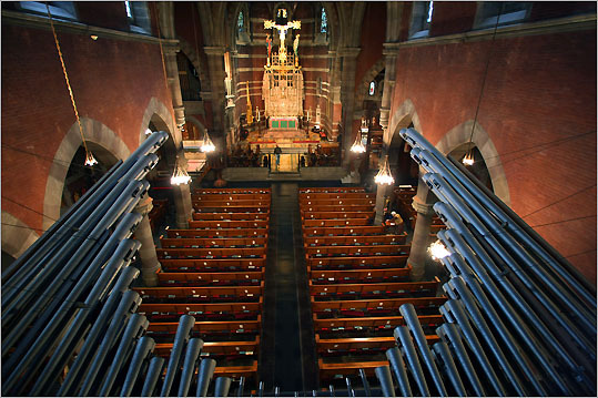 Some of the Church of the Advent organ pipes protrude from high in back of the church.