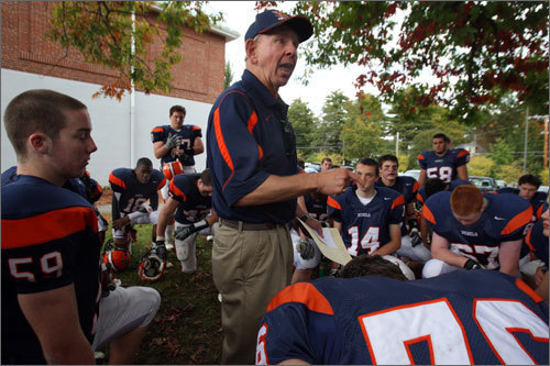 Coach Barry Greener and the Walpole High School football team.