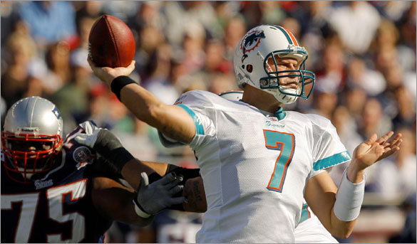 Dolphins quarterback Chad Henne dropped back to pass in the first quarter.