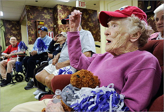 "Barbara King, 87, held her teddy bear ""Champ'' as she and other Beaumont Rehabilitation and Skilled Nursing Center residents watched the Patriots game on TV yesterday."