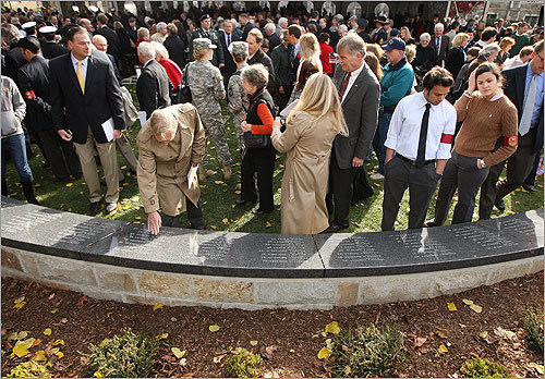 Attendees viewed the memorial wall during the Boston College Veterans Day ceremony. The wall commemorates BC alumni who fell in wars.